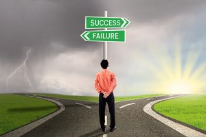 Businessman is choosing success or failure road